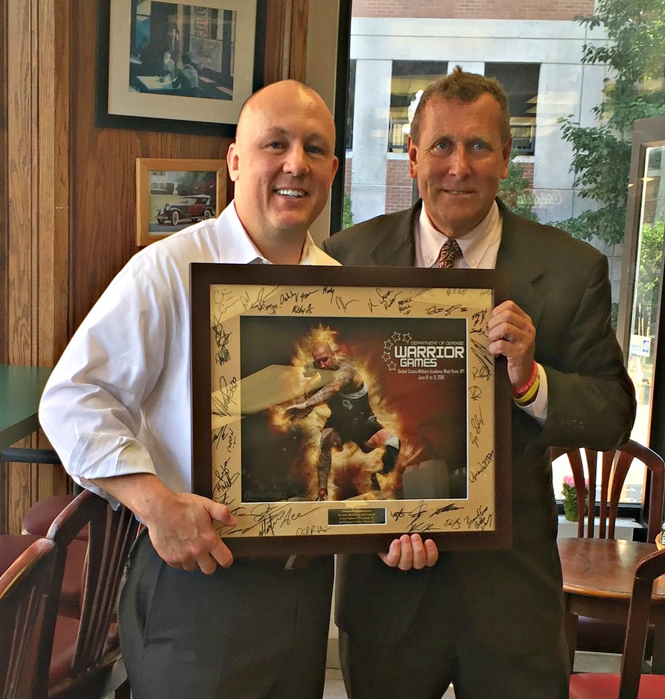 Warrior Games Representative Presents Award to UMA President